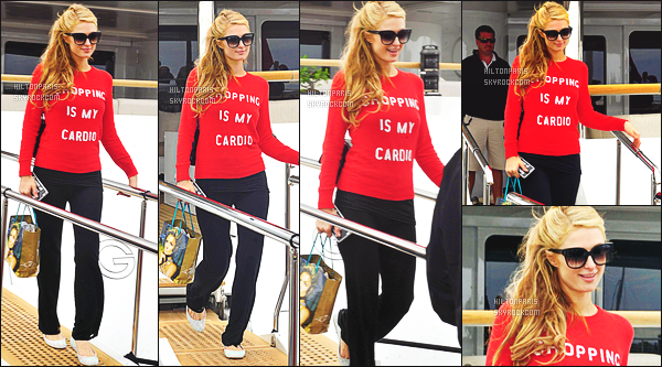 --------  21/05/15 :   Paris Hilton  souriante photographiée quittant un yach de luxe dans la journée - à Cannes.   J'aime la tenue, surtout son pull rouge. J'aime la coiffure simple, attaché ( Lunette: Dita Paradis ~ Pantalon: Splendid ~ Sac: Chanel ).   --------