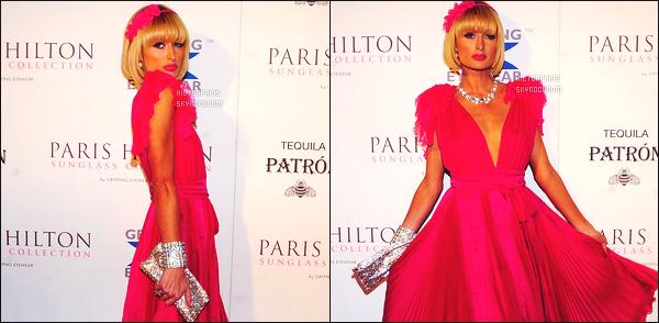 ------- 27/03/09:   Paris Hilton   photographiée    assistant à l'événement de  «  Gripping Eyewear » dans la soirée -  à Miami.  Paris Hilton est vraiment top, j'aime la longue robe, souple, et ample, top pour la couleur aussi. elle est accompagnée de Doug Reinhardt.     -------