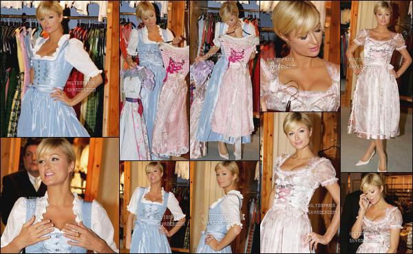 --------  12/02/06  :  Notre princesse Paris Hilton photographiée vue dans une boutique dans la journée à Munich.  Paris Hilton essaye des tenues assez traditionnelles, mais j'aime beaucoup cela lui va bien, j'aime aussi la coiffure tiré en chignon. Gros top.--------