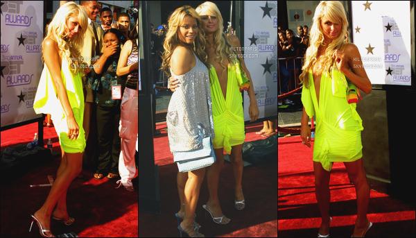--------  24/06/03  :    La miss Paris Hilton photographiée  à la grande cérémonie des «  BET Awards » à   Los Angeles.  J'aime beaucoup cette robe, c'est le style à l'epoque j'ai envie de dire, mais la couleur va vraiment bien à notre sublime Paris, j'adore trop.--------