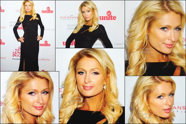--------  17/11/11  :   Notre princesse Paris Hilton photographiée à la soirée « Virgin Unite's 5th  » - à Los Angeles.  J'adore la tenue qu'elle porte, cette longue robe noire sombre, lui va tellement bien à Paris, je suis fan de son maquillage et de la coiffure.--------