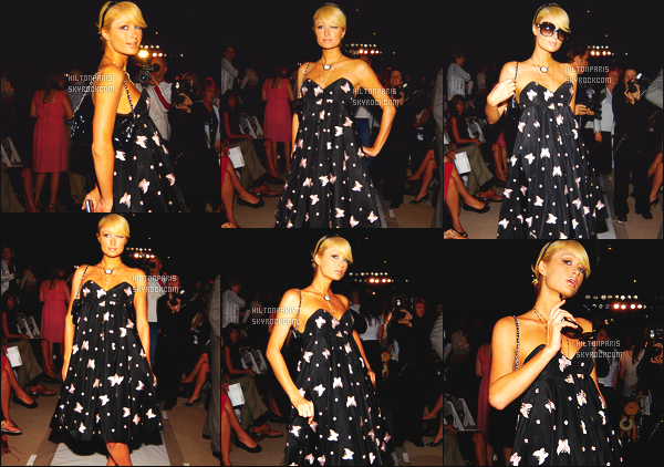 --------  10/09/06  :   Sublime Paris Hilton photographiée  à la grande Fashion Week de   « Luca Luca  »  -  à  New York.   Petit top pour la tenue, j'aime beaucoup la longueur moitié longue, et moitié courte. Elle est trop belle, j'adore aussi la coiffure. Top/Flop?--------
