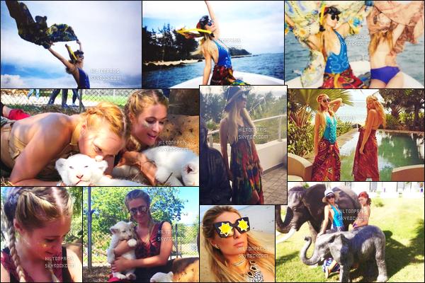 ------- 19/12/16: Jolie Paris Hilton  photographiée sur le tournage d'un shooting à la plage dans la journée   à Mauritius. Petit top à la jolie Paris Hilton pour cette robe trés coloré, je ne suis pas trop fan mais ca passe, j'aime trop ses petites tresses tirés. Top/Flop?    -------