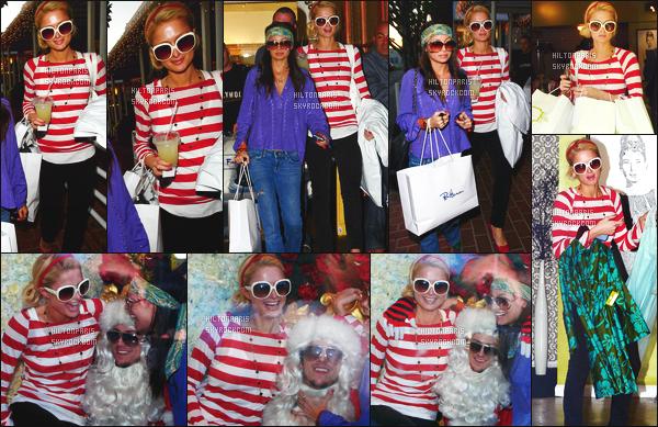 --------  04/12/06  :   Mlle Paris Hilton photographiée entrain de faire du shopping à   « Fred Segal » -  à Los Angeles.  Elle est accompagnée d'amis y compris Nicole Richie.  J'aime bien cette tenue, Paris est vraiment toute belle en rouge, je suis fan. Top/Flop?--------