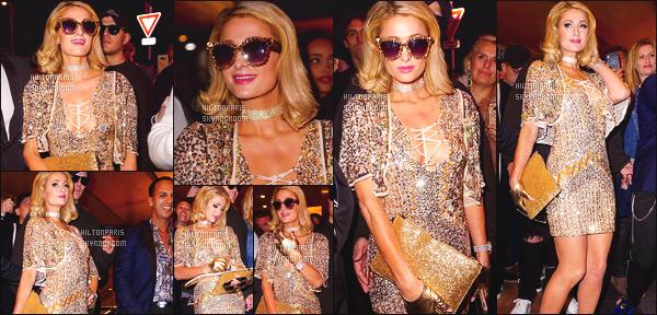 ------- 15/05/18: Mlle Paris   photographiée assistant à une soirée dans la boite de nuit Vip Room avec Chris - à Cannes.  (+) Quelques photos de cette soirée partagés sur les reseaux sociaux. Je lui accorde un gros top. J'adore la robe dorée courte, gros top. -------