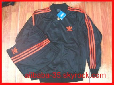 SURVETEMENT ADIDAS NOIR BANDE ORANGE