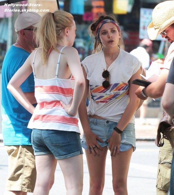 "Dakota Fanning et Elizabeth Olsen sur le tournage de leur prochain film ""Very Good Girls"" à New York. Jeudi, 05 juillet"