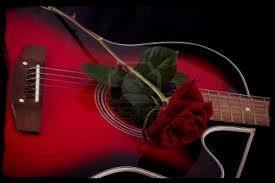 Une rose rouge pour un morceau joué à la guitare !!!
