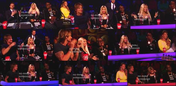 ------- 28/03/13:  Belle Minaj dans son role de juge photographiée lors d'un prime pour « American Idol »  - à New York.  Mlle Nicki porte un blazer à carreaux Chic et une paire de bottine Christian Louboutin. J'adore son collier Barbie.  Top/Flop pour la tenue?  -------
