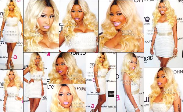 ------- 23/02/13:  La sublime Nicki Minaj photographiée assistant à un repas d'aides contre le « Sida »  - à Los Angeles. Se repas est organisé par Elton John. Nicki porte une robe blanche Cavalli et une paire de talon Olcay Gulsen. Top/Flop pour la tenue?  -------