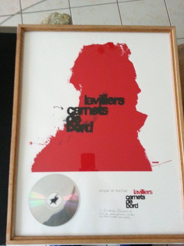 """disque de platine """"carnet de bord""""  pour avoir vendu 3OO.OOO album _année 2004"""