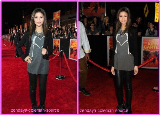 """Zendaya était présente à la première du nouveau film Disney """"John Carter"""" le 22 février 2012  et pour une fois Zendaya était accompagnée de Bella et honnêtement sa fait plaisir de les voir à nouveau sur un tapis rouge =D . Coté tenue : Pour moi c'est un TOP , Zendaya portait des motarde , un slim en cuire noir , un T-Shirt gris avec des mains squelletique qui font un coeur (on peut voir que Zendaya fait des coeur aux photographes) , une veste noir ainsi qu'un collier et une bague . Coté maquillage : Zendaya à optée pour un maquillage sombre qui allait trés bien avec sa tenue . Coté coiffure ; Zendaya avait lisée ses cheveux . Et pour vous TOP ou FLOP ?"""