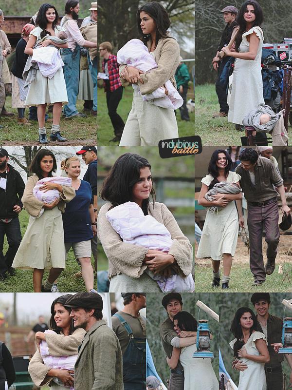 Selena holding babies