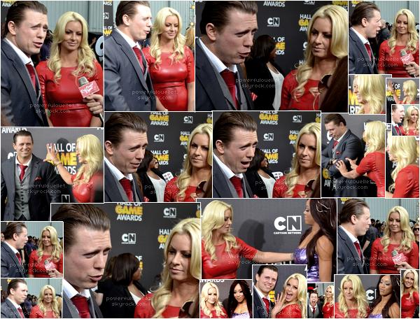 _♦ 15 FÉVRIER 2014 - HALL OF GAME AWARDS 2014 ___________________________________________________CANDID RED CARPET Maryse avec son mari Mike ont assistés à la cérémonie Game Awards 2014 qui et des récompenses décernées par le réseau télévisé américain Spike TV honorant les meilleurs jeux vidéos de l'année. Le but de gagner en notoriété, les cérémonies ont accueilli depuis 2003 un grand nombre de personnalités dans les domaines de la musique, du cinéma et de la télévision, et certains studios profitent de l'occasion pour présenter leurs derniers trailers pour leurs jeux à venir. Il y avait aussi la sublime Alicia Fox divas actuel de la wwe qui été aussi à cette célèbre cérémonie. Maryse portait une magnifique robe ' Paola ' rouge leatherette et lesh badycon elle l'a acheter elle l'a acheter sur le site CelebBoutique, cette robe coûte 143 euros. Maryse porter des Sandal Platforme vogue 31 qu'elle a acheter sur le site Amazon.com à 47,95$.